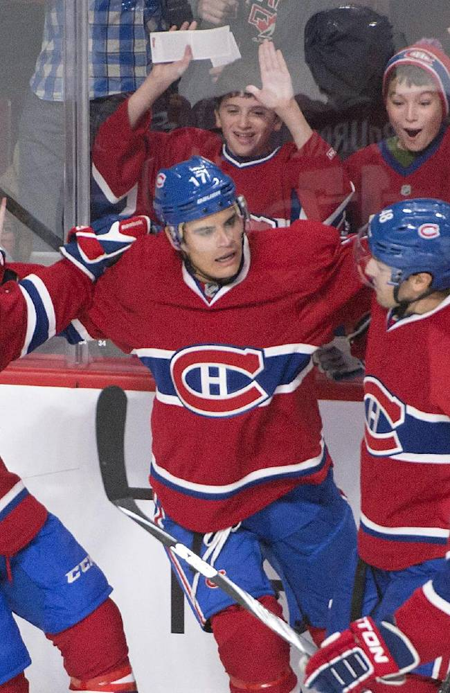 Montreal Canadiens' Rene Bourque, second from left, celebrates his goal with teammates David Desharnais, (51), Daniel Briere, (48), and P.K. Subban  during the first period of an NHL hockey game, Thursday, Oct. 17, 2013 in Montreal
