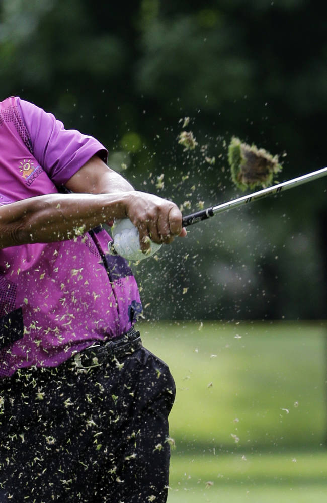 Esteban Toledo, of Mexico, hits an iron on the ninth hole during the first round of the Encompass Championship golf tournament in Glenview, Ill., Friday, June 20, 2014