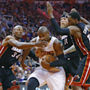 Phoenix Suns guard Leandro Barbosa (10) gets his nose bent to the side by Miami Heat guard Ray Allen (34) during the first half of an NBA basketball game Tuesday, Feb. 11, 2014, in Phoenix The Associated Press