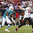 Tampa Bay Buccaneers quarterback Josh McCown (12) throws a pass as he is chased by Miami Dolphins defensive end Olivier Vernon (50) during the first quarter of an NFL preseason football game Saturday, Aug. 16, 2014, in Tampa, Fla The Associated Press