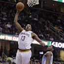 Cleveland Cavaliers' Tristan Thompson (13), from Canada, jumps to the basket against Denver Nuggets' Kenneth Faried (35) during the second quarter of an NBA basketball game on Wednesday, Dec. 4, 2013, in Cleveland The Associated Press