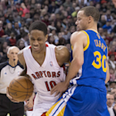 Toronto Raptors' DeMar DeRozan, left, drives past Golden State Warriors' Stephen Curry during second half NBA basketball action in Toronto, Sunday, March 2, 2014 The Associated Press