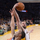 Memphis Grizzlies guard Courtney Lee, left, and Los Angeles Lakers guard Jordan Farmar battle for a rebound during the first half of an NBA basketball game, Sunday, April 13, 2014, in Los Angeles The Associated Press
