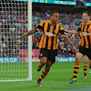 Hull City's Tom Huddlestone, centre, celebrates after scoring against Sheffield United during their English FA Cup semifinal soccer match between Hull City and Sheffield United at Wembley Stadium, in London, Sunday, April 13, 2014