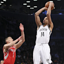 Brooklyn Nets guard Shaun Livingston (14) shoots over Houston Rockets guard Jeremy Lin (7) during the first half of their NBA basketball game at the Barclays Center, Tuesday, April 1, 2014, in New York The Associated Press