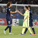 Barcelona's Lionel Messi, right, shakes hand with PSG's David Luiz at the end of the Champions League Group F soccer match between Paris Saint German and Barcelona at Parc des Princes stadium in Paris, France, Tuesday, Sept. 30, 2014. PSG defeated Barcelona 3-2. (AP Photo/Michel Euler)