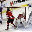 Toronto Maple Leafs' Phil Kessel (81) flies into the net as he scores on New Jersey Devils goalie Cory Schneider as Leafs' James van Riemsdyk (21) and Devils' Marek Zidlicky, (2) of the Czech Republic, skate in during the third period of an NHL hockey gam