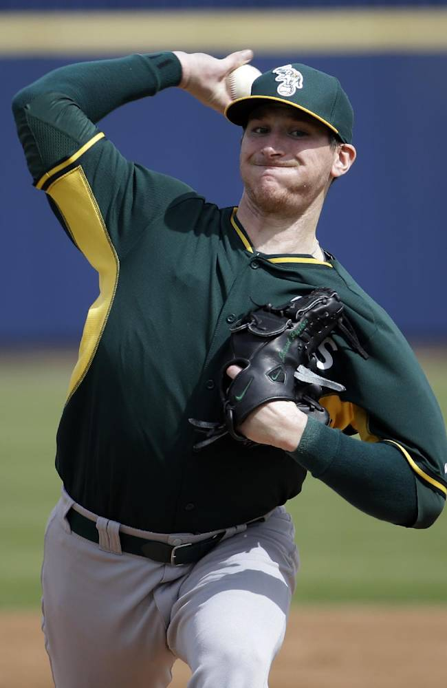 Oakland Athletics' Jarrod Parker throws before the first inning of an exhibition spring training baseball game against the Milwaukee Brewers Wednesday, March 5, 2014, in Phoenix