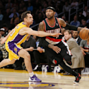 Portland Trail Blazers guard Mo Williams, right, drives around Los Angeles Lakers guard Steve Nash during the first half of an NBA basketball game in Los Angeles, Tuesday, April 1, 2014 The Associated Press