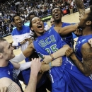 Florida Gulf Coast's Sherwood Brown, center, celebrates with teammates after their 81-71 win over San Diego State in a third-round game in the NCAA college basketball tournament, Sunday, March 24, 2013, in Philadelphia. Florida Gulf Coast became the first No. 15 seed to make the Sweet 16. (AP Photo/Michael Perez)