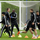 Chelsea's, from left, Eden Hazard, John Terry, Demba Ba, Branislav Ivanovic and Fernando Torres take part in a training session at their facilities in Stoke d'Abernon, near London, Monday, April 7, 2014. Paris Saint-Germain take a 3-1 lead from the first