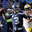Seattle Seahawks quarterback Russell Wilson drops back to pass during the first half of the NFL football NFC Championship game against the Green Bay Packers Sunday, Jan. 18, 2015, in Seattle The Associated Press