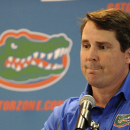 Florida NCAA college head football coach Will Muschamp fields questions from reporters during Media Day at the University of Florida in Gainesville, Fla., Sunday, Aug, 3, 2014. (AP Photo/Phil Sandlin)