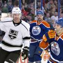 Los Angeles Kings Jeff Carter (77) celebrates a goal as Edmonton Oilers Mark Fraser (5) and Jordan Eberle (14) look on during first period NHL hockey action in Edmonton, Canada, Sunday March 9, 2014. (AP Photo/The Canadian Press, Jason Franson)