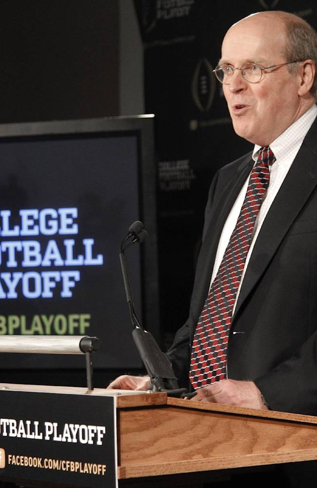 Bowl Championship Series Executive Director Bill Hancock announces the 13 members of the College Football Playoff committee during a news conference, Wednesday, Oct. 16, 2013, in Irving, Texas. Former Secretary of State Rice, former Nebraska coach Tom Osborne and College Football Hall of Fame quarterback Archie Manning are among the 13 people who will be part of the College Football Playoff selection committee in 2014