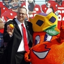 Northern Illinois head coach Rod Carey poses for photos with Obie, the Orange Bowl mascot, as the team arrives at Miami International Airport, Wednesday, Dec. 26, 2012, in Miami. Northern Illinois is scheduled to play Florida State in the Orange Bowl NCAA college football game on Tuesday, Jan. 1, 2013. (AP Photo/The Miami Herald, Emily Michot)