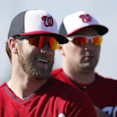 Washington Nationals left fielder Bryce Harper, left, smiles with Ryan Zimmerman during a spring training baseball workout, Thursday, Feb. 20, 2014, in VIera, Fla The Associated Press