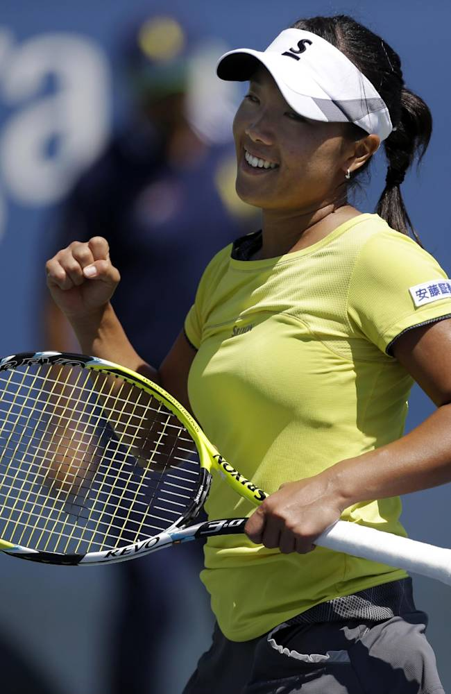Kurumi Nara, of Japan, reacts after defeating Aleksandra Wozniak, of Canada, during the opening round of the 2014 U.S. Open tennis tournament, Monday, Aug. 25, 2014, in New York