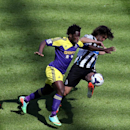 Newcastle United's captain Fabricio Coloccini, right, vies for the ball with Swansea City's Wilfried Bony, left, during their English Premier League soccer match at St James' Park, Newcastle, England, Saturday, April 19, 2014