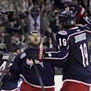 Columbus Blue Jackets' Nick Foligno celebrates his goal against the Boston Bruins during the second period of an NHL hockey game Saturday, Dec. 27, 2014, in Columbus, Ohio. (AP Photo/Jay LaPrete)