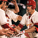 Cards hit 3 HRs, top Reds, move closer to playoffs (Yahoo Sports)
