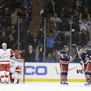 Detroit Red Wings' Brendan Smith (2), goalie Jimmy Howard (35) and Joakim Andersson (18) watch as the New York Rangers celebrate a goal by Brian Boyle (22) during the first period of an NHL hockey game on Sunday, March 9, 2014, in New York The Associated