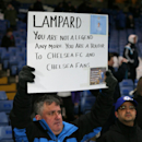 A fan holds up a placard ahead of the English Premier League soccer match between Chelsea and Manchester City at Stamford Bridge, London, England, Saturday, Jan. 31, 2015