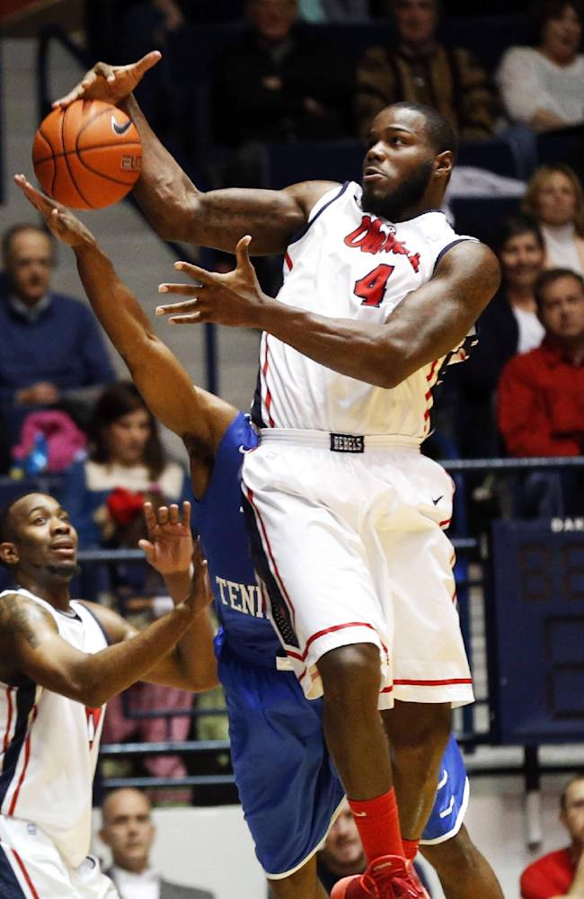 Mississippi center Demarco Cox (4) pulls in a loose rebound against Middle Tennessee State in the second half of an NCAA college basketball game in Oxford, Miss., Saturday, Dec. 14, 2013. Mississippi won 72-63