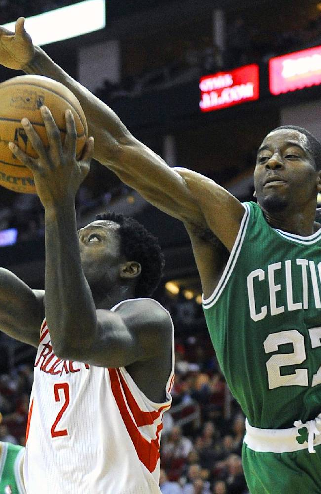 Boston Celtics' Jordan Crawford (27) tries to block a shot by Houston Rockets' Patrick Beverley (2) in the second half of an NBA basketball game Tuesday, Nov. 19, 2013, in Houston. The Rockets won 109-85