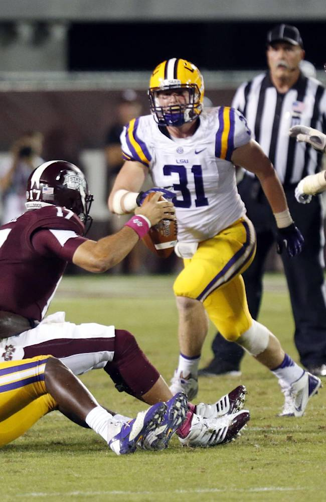 LSU linebacker Lamin Barrow (18) sacks Mississippi State quarterback Tyler Russell (17) in the second half of their NCAA college football game in Starkville, Miss., Saturday, Oct. 5, 2013. No. 10 LSU won 59-26