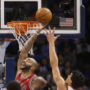 Chicago Bulls forward Carlos Boozer (5) and Oklahoma City Thunder center Steven Adams (12) reach for a rebound during the first quarter of an NBA basketball game in Oklahoma City, Thursday, Dec. 19, 2013. (AP Photo/Sue Ogrocki)