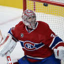 Montreal Canadiens goalie Carey Price keeps his eyes on the puck against the Carolina Hurricanes during the third period of an NHL hockey game Tuesday, Dec. 16, 2014, in Montreal The Associated Press