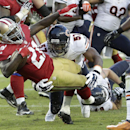 San Francisco 49ers running back Frank Gore (21) scores on an 8-yard touchdown run past Chicago Bears inside linebacker Jon Bostic (57) during the second quarter of an NFL football game in Santa Clara, Calif., Sunday, Sept. 14, 2014 The Associated Press
