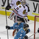 San Jose Sharks right wing Melker Karlsson (68) celebrates with teammate Joe Pavelski (8) after scoring a goal against Chicago Blackhawks goalie Antti Raanta (31) during the first period of their NHL hockey game Saturday, Jan. 31, 2015, in San Jose, Calif. (AP Photo/Eric Risberg)