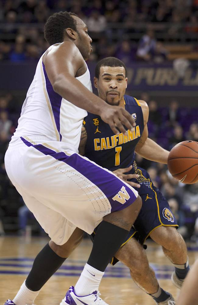 California's Justin Cobbs drives to the basket while Washington's Perris Blackwell defends during the first half of an NCAA college basketball game Saturday, Feb. 15, 2014