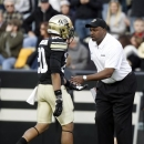 FILE - In this file photo taken on Nov. 23, 2012, Colorado head coach Jon Embree, right, greets a player as he leaves the field in the fourth quarter of Utah's 42-35 victory of an NCAA football game in Boulder, Colo. Embree tells The Associated Press he has been fired as coach of the University of Colorado football team. He was fired on Sunday, Nov. 25 by Colorado after two seasons. (AP Photo/David Zalubowski, file)