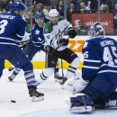 Dallas Stars' Tyler Seguin, (91) shoots wide of the Toronto Maple Leafs goal as Leafs captain Dion Phaneuf and goaltender James Reimer defend during the third period of an NHL hockey game, Tuesday, Dec. 2, 2014 in Toronto The Associated Press