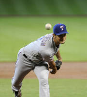 Texas Rangers' Yu Darvish, of Japan, delivers a pitch against the Houston Astros in the first inning of a baseball game, Monday, Aug. 12, 2013, in Houston. Darvish pitched seven and one-third inning before giving up a hit, a solo homer to Carlos Corporan, in the Rangers' 2-1 win. (AP Photo/Pat Sullivan)