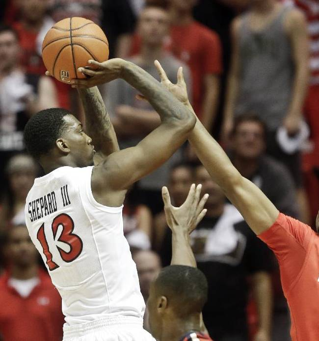 San Diego State forward Winston Shepard, left, shoots over Arizona guard Jordin Mayes during the first half of an NCAA college basketball game Thursday, Nov. 14, 2013, in San Diego