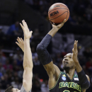 Baylor forward Cory Jefferson shoots over Creighton forward Doug McDermott during the first half of a third-round game in the NCAA college basketball tournament Sunday, March 23, 2014, in San Antonio. (AP Photo/Eric Gay)