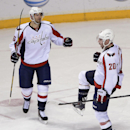 Washington Capitals right wing Troy Brouwer (20) celebrates with Eric Fehr (16) after scoring a goal in the second period of an NHL hockey game against the Nashville Predators on Sunday, March 30, 2014, in Nashville, Tenn The Associated Press