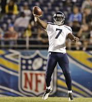 Seattle Seahawks quarterback Tarvaris Jackson releases a long pass that was completed for a 41 gain against the San Diego Chargers in the third quarter of an NFL preseason football game Thursday, Aug. 8, 2013, in San Diego. (AP Photo/Gregory Bull)