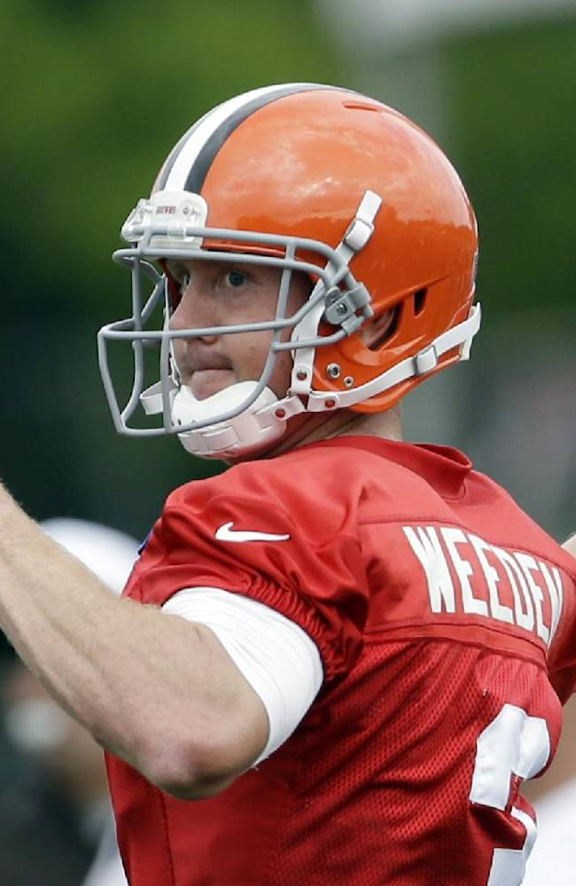 In this Aug. 6, 2013 file photo, Cleveland Browns quarterback Brandon Weeden throws the ball during training camp at the NFL football team's facility in Berea, Ohio. Weeden called Sports Illustrated's allegations of widespread corruption within Oklahoma State's football program