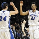 Saint Louis' Cody Ellis (24) high-fives Dwayne Evans after scoring during the second half of an NCAA college basketball game against Butler in the semifinals of the Atlantic 10 Conference tournament, Saturday, March 16, 2013, in New York. Saint Louis won 67-56. (AP Photo/Mary Altaffer)
