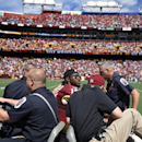 Washington Redskins quarterback Robert Griffin III (10) leaves the game on a cart after injuring his left ankle during the first half of an NFL football game against the Jacksonville Jaguars Sunday, Sept. 14, 2014, in Landover, Md. The Redskins have said