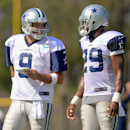 Dallas Cowboys quarterback Tony Romo (9) and running back DeMarco Murray (29) talk things over during the NFL football team's training camp, Saturday, July 26, 2014, in Oxnard, Calif The Associated Press