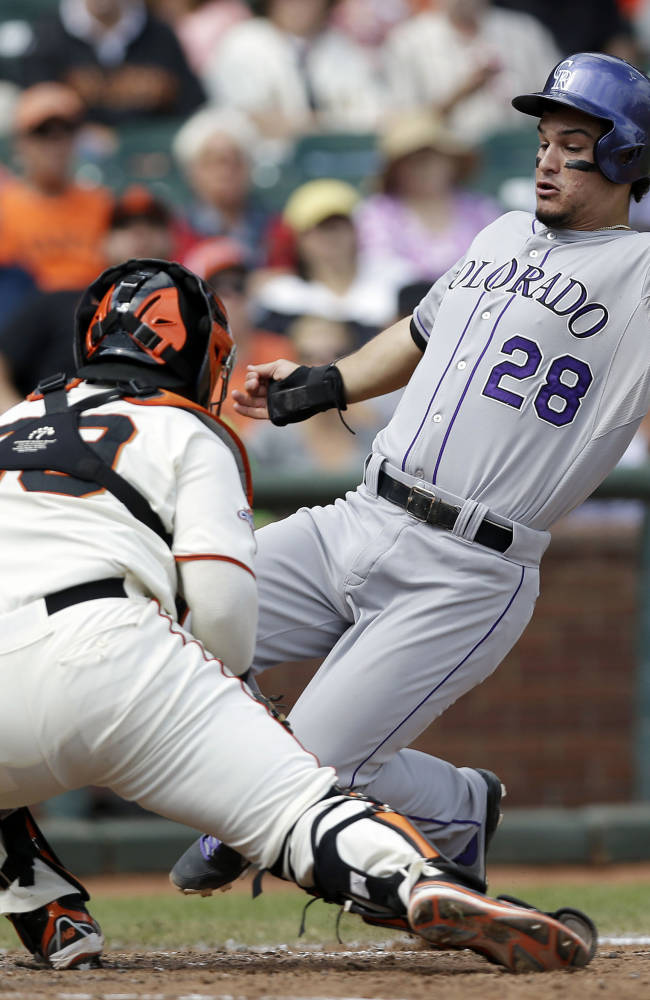 Giants rally for 4-3 win over Rockies