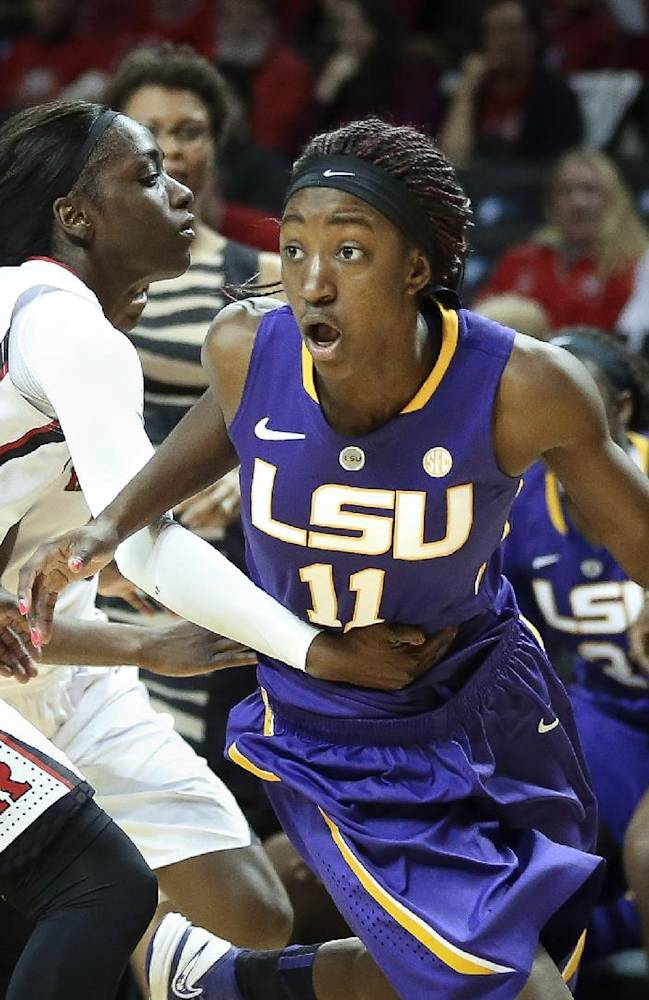 LSU guard Raigyne Moncrief (11) drives past Rutgers guard Kahleah Copper (2) during the second half of an NCAA college basketball game at the Barclays Center Women's Invitational, Friday, Nov. 29, 2013, in New York. LSU defeated Rutgers, 69-65