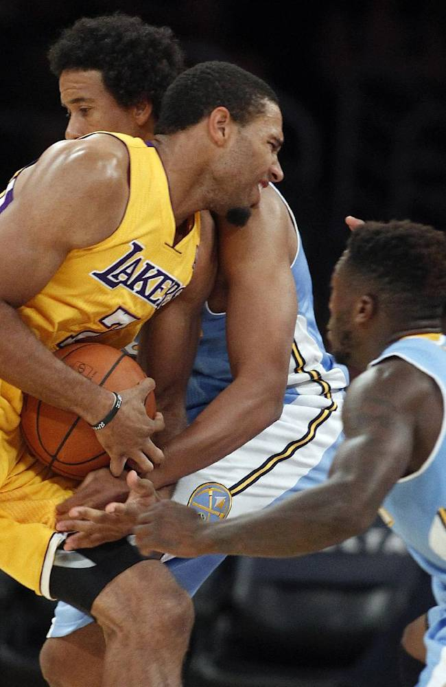 Los Angeles Lakers guard Xavier Henry, center, has the ball stripped away by Denver Nuggets guard Andre Miller, left, with Nuggets guard Nate Robinson, right, defending in the fourth quarter of an NBA preseason basketball game Sunday, Oct. 6, 2013 in Los Angeles. The Nuggets won 97-88