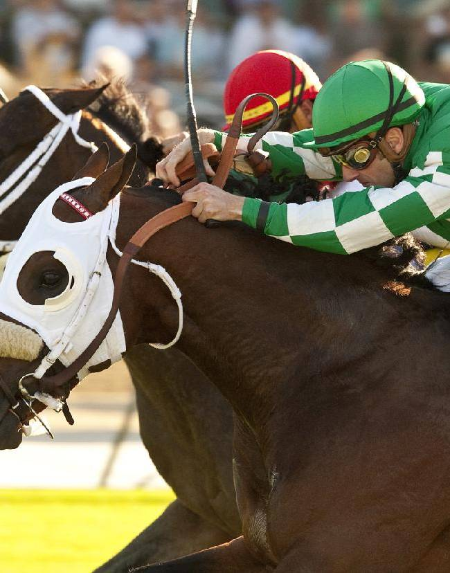 In this image provided by Benoit Photo, Chips All In, foreground, with Julien Leparoux aboard, overpowers Boat Trip, with Garrett Gomez aboard, to win the Grade III, $100,000 Eddie D. Stakes horse race on Friday, Sept. 27, 2013, at Santa Anita Park, Arcadia, Calif